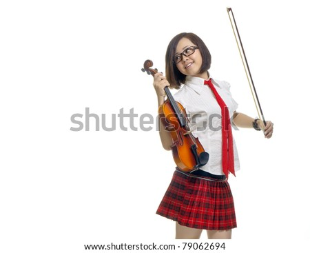 Young and beautiful teenager school girl poses with violin, isolated background - stock photo