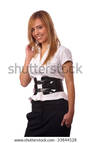 young and beautiful white-headed girl in white blouses and black skirt with a wide belt of varnish on a light background