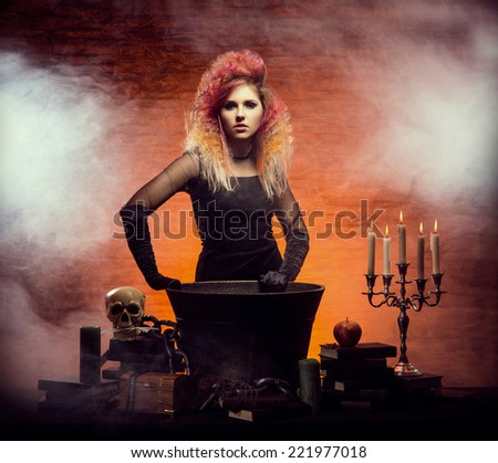 Young and beautiful witch making a witchcraft in dungeon. Halloween composition. - stock photo