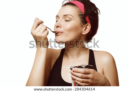 young and beautiful woman eating a delicious ice cream with chocolate - stock photo