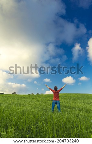 Young and beautiful woman feeling the nature - stock photo