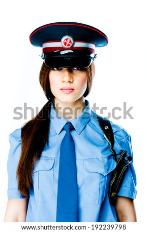 young and beautiful woman in police uniform - stock photo