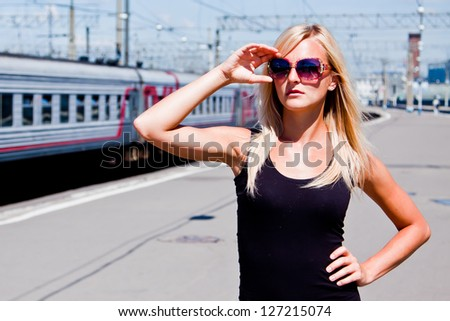 young and beautiful woman on the platform - stock photo
