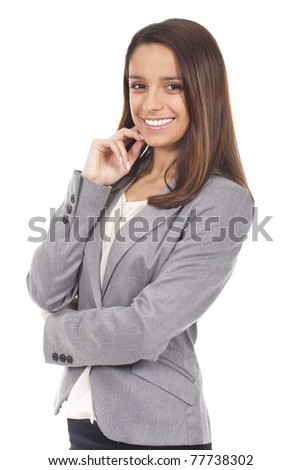 young and beautiful woman standing and smiling - stock photo
