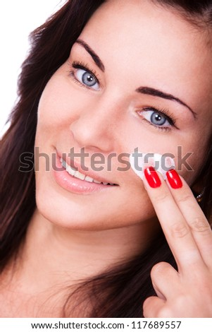 Young and beautiful woman with clean skin over white background