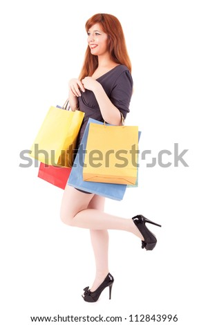 Young and beautiful woman with shopping bags