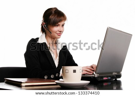 Young and beautiful woman working with laptop on the white background