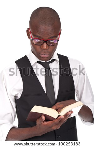 young and black man holding and reading a book