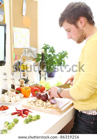 Young and cheerful woman cooking healthy food