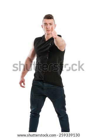 Young and confident male stud showing thumb up on white background - stock photo