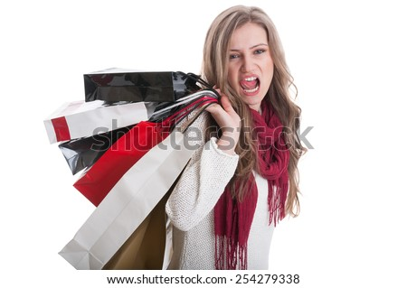 Young and cute shopping girl acting sexy and kinky - stock photo