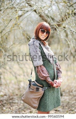 Young and cute woman with sunglasses outdoors - stock photo