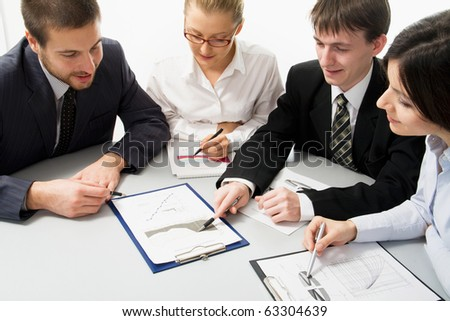 Young and good-looking business people are working in the meeting room - stock photo