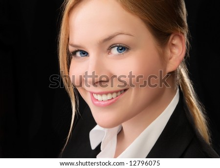 Young and good  looking business woman. Portrait of a beautiful friendly young woman - stock photo