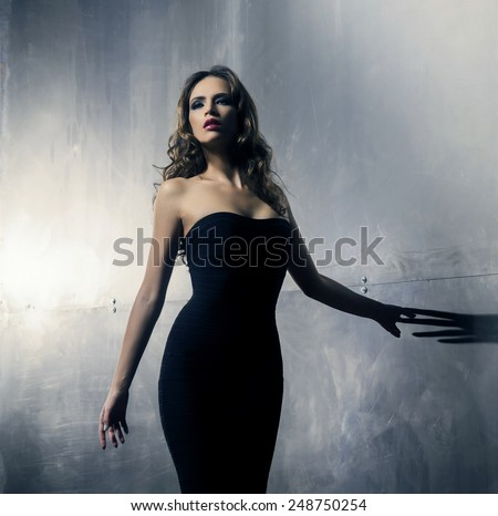 Young and gorgeous actress over a metal wall background - stock photo