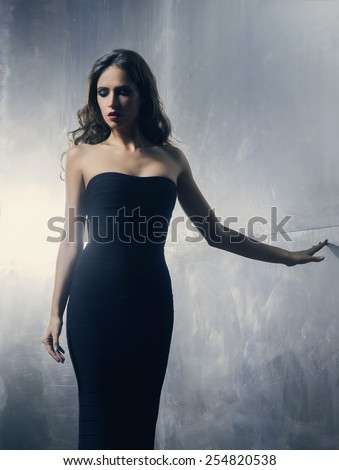 Young and gorgeous actress over a metal wall background
