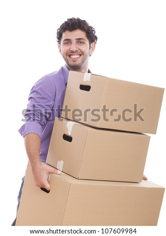 Young and handsome guy carrying boxes over white background - stock photo