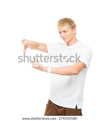 Young and handsome teenage boy working with an imaginary and invisible touchscreen isolated on white - stock photo