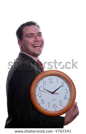 young and happy businessman hplding wall clock
