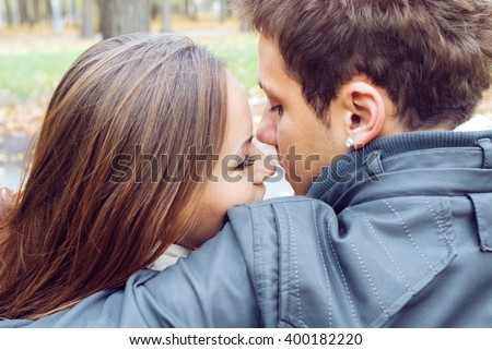 Young and happy couple on the walk in the park - stock photo