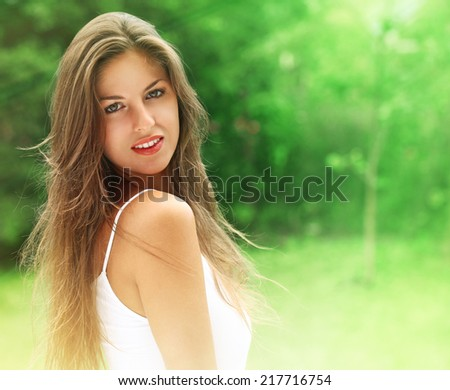 Young and happy girl in the park  - stock photo