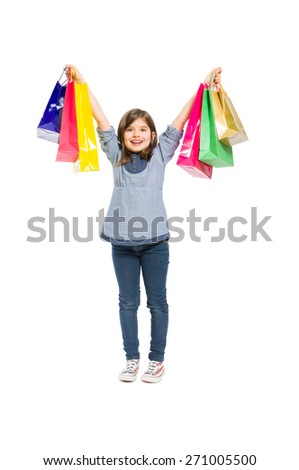 Young and happy shopping girl smiling on white background - stock photo