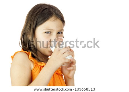 Young and healthy girl drinking a glass of milk