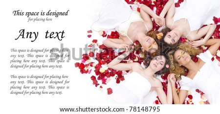 Young and healthy girls with a lot of rose petals - stock photo