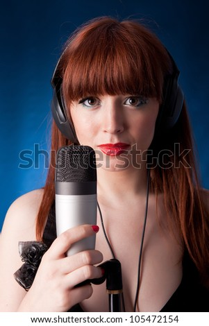 Young and hot singer, isolated over white background