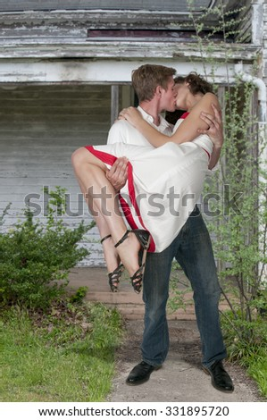 Young and in love married couple kissing - stock photo