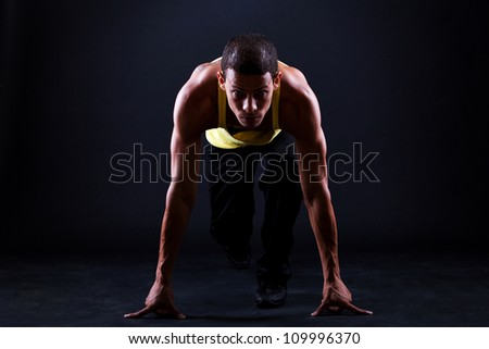 Young and muscular hispanic man is ready for run - stock photo