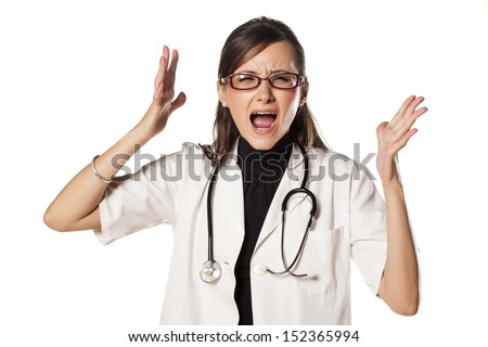 young and nervous woman doctor with a stethoscope around her neck yell at you