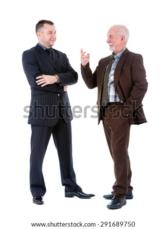 Young and old senior two businessman in suits discussing. Isolated on white background, Negative human emotion, facial expression - stock photo