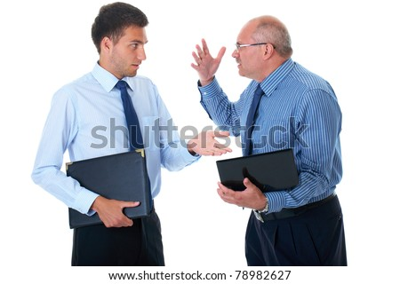 young and older businessman have argument over their work, one of them hold small computer, isolated on white - stock photo