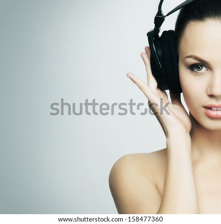 Young and pretty teenage girl listening to the music - stock photo
