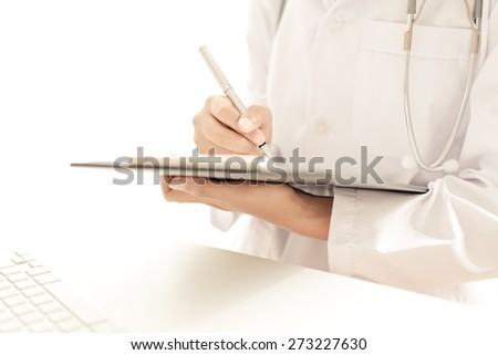 Young and professional doctor working in office