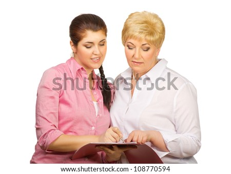 Young and senior women with folder isolated - stock photo