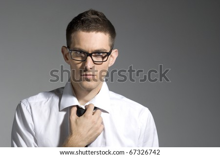 Young and serious businessman in glasses - stock photo