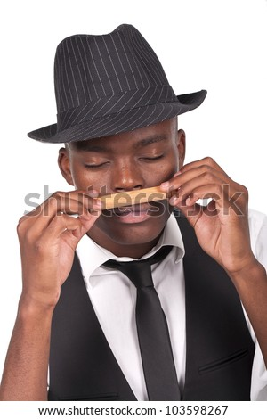 young and sexy black man wearing a hat and smelling a cigar
