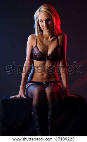 Young and sexy woman in erotic lingerie - stock photo
