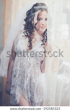 Young and sexy woman in white lingerie. bride with hairstyle and bright makeup. Happy sexy girl waiting for groom. lady in bridal dress have final preparation for wedding. Body in sexy bridal lingerie