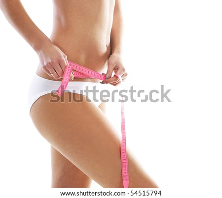 Young and sexy woman measuring her waist isolated over white background - stock photo