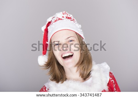 Young and sexy woman welcomes Christmas