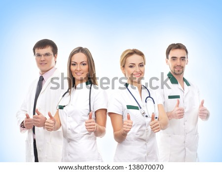 Young and smart doctors over blue background - stock photo