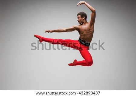 Young and stylish modern ballet dancer on gray background