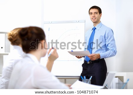 Young and successful businessman in the office - stock photo