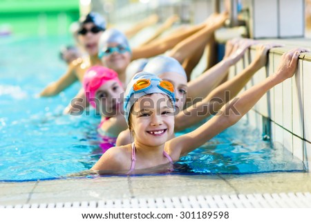 young and successful swimmers pose - stock photo