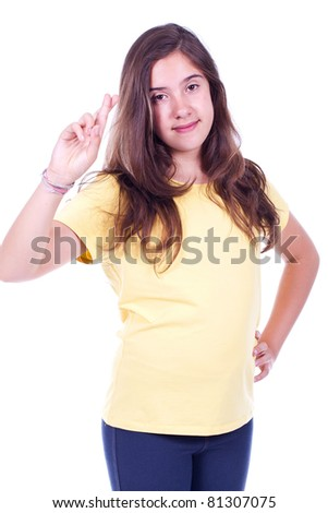 young and teenage girl with fingers crossed - stock photo