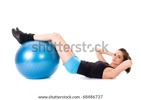 young and very attractive female exercise using blue fitness ball, studio shoot isolated on white
