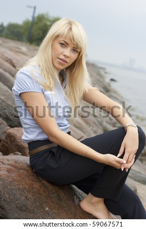 Young and very attractive woman relaxes on the sea shore